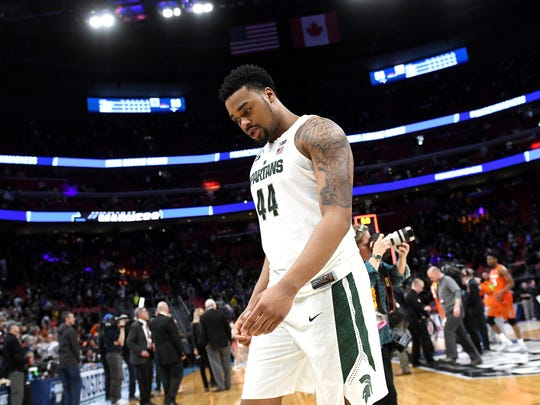 Michigan State's Nick Ward walks to the locker room