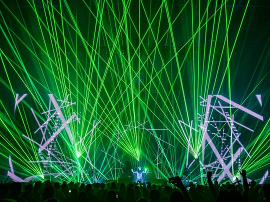 Jean-Michel Jarre intergrates electronic music and laser lights to deliver political messages
