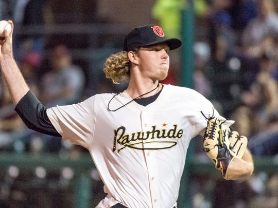 Visalia Rawhide's Sam McWilliams pitches against the Rancho Cucamonga Quakes for their 2018 season opener on Thursday, April 5, 2018.