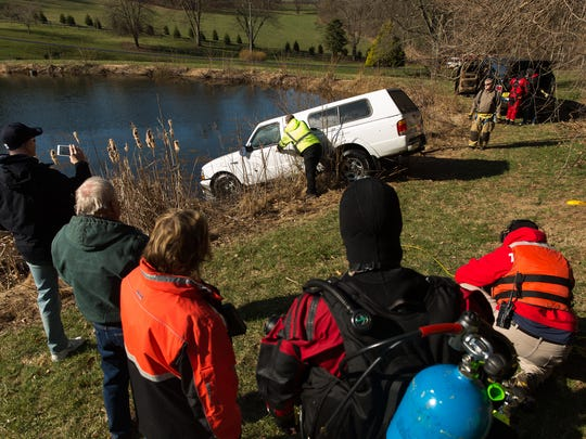A 1999 Ford Ranger is towed from the water after it rolled down a hill on the first block of Beaver Creek road, early Sunday, April 8, 2018 in Berwick Township. No one was in the vehicle, which rolled down a hill and into the pond after the owner started the vehicle to warm it up and set the emergency brake.
