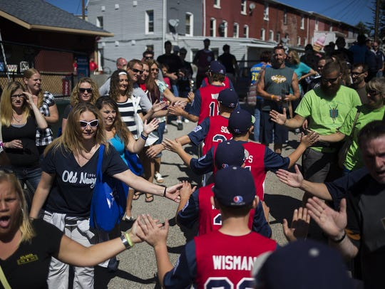 Red Land Little League team members exit through the