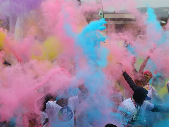 Color fills the air July 14 during the Color Run, a benefit for the Mental Health Association of the Southern Tier.