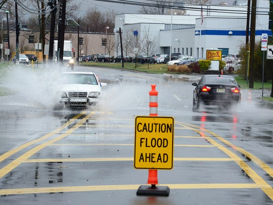 A sign warning drivers of the high water on Moonachie Ave in Moonachie on Monday morning April 16, 2018.