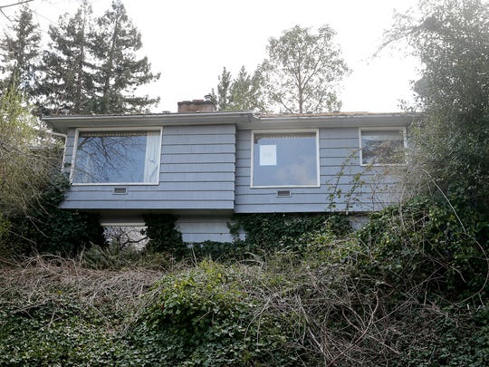 A dilapidated home that was for sale near Olympic College.