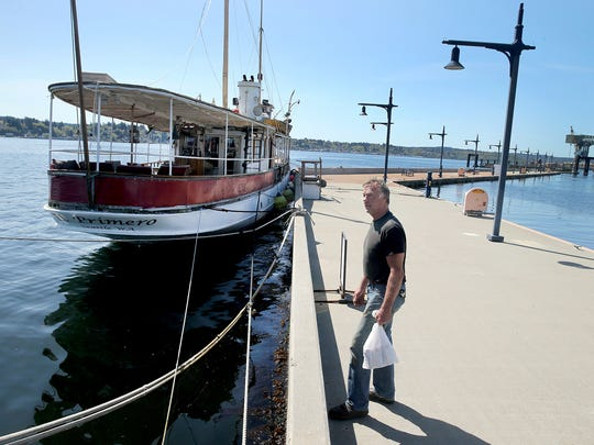 Christian Lint is on the breakwater of the Bremerton Marina, where two of his historic yachts are moored. Proponents of allowing moorage on the breakwater say it gives the public access to vessels. Some engineers worry the breakwater can't handle the vessel moorage.