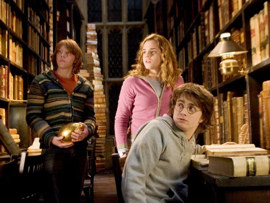 "Rupert Grint, Emma Watson and Daniel Radcliffe pictured in ""Harry Potter and the Goblet of Fire."""