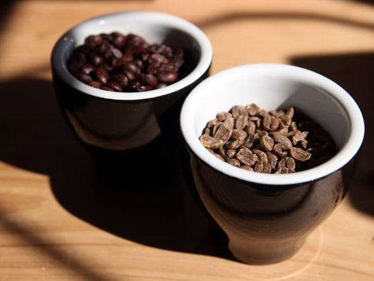 Roasted, left, and unroasted coffee beans.