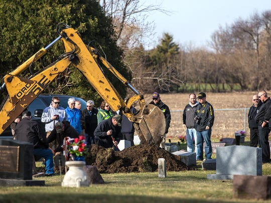 Fond du Lac County Sheriff's Office officials and two anthropologists stand by Thursday, April 26, 2018 as the grave of Fond du Lac County's Jane Doe is exhumed for new tests that may help determine where and who she may be. Her body was discovered in southeast Fond du Lac County on November 23, 2008 and was buried in Cattaraugus Cemetary near Waupun in December of 2011. Doug Raflik/USA TODAY NETWORK-Wisconsin