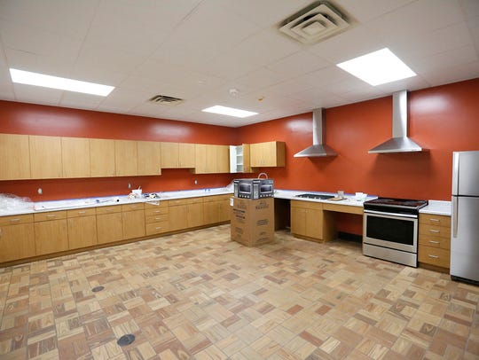 A kitchen area nears completion Thursday, April 26,
