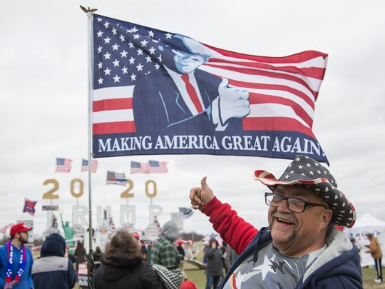Randal Thom of Lakefield, MN, in front of his Trump flag during President Donald J. Trump's Make America Great Again rally at Total Sports Park in Washington Township, Saturday, April 28, 2018.