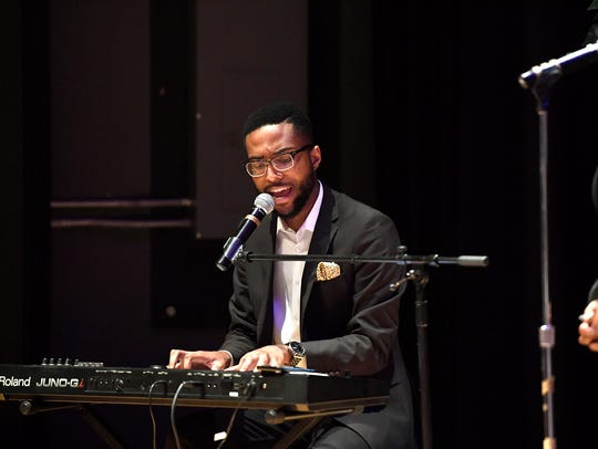 Noel Gordon, Jr. performs during the 21st Annual Candlelight
