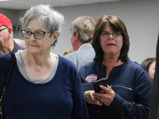 Candidate Sherry Anderson looks at early voting totals
