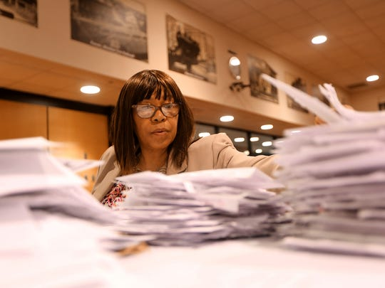 Ernestine Dl sorts mail-in ballots at the Passaic County building in Paterson. Tuesday, May 8, 2018
