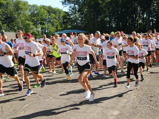 The Colors of Independence 5K Run/Walk in July 2017 at Highland Park in Endwell.
