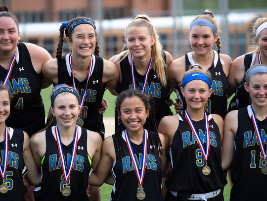 The Kennard-Dale Rams pose with their medals after