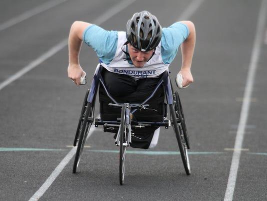 636619307518768570-sp.District-track-BF-boys-100-wheelchair.jpg