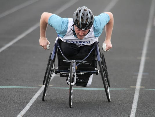 636619307518768570-sp.District-track-BF-boys-100-wheelchair.jpg