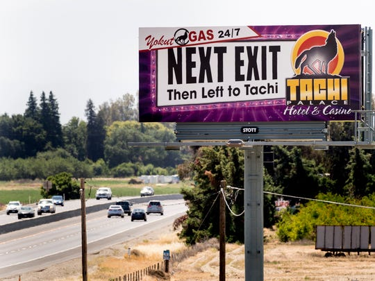 A billboard for Tachi Palace Hotel & Casino as seen from the Houston Avenue overpass on Highway 298 in Lemoore, Calif.