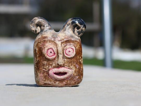 A stoneware Chibi Oni sculpture by Jo Mechan, Old School