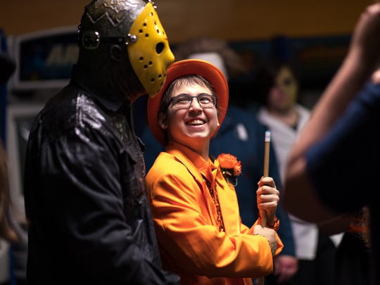 "Logan Scheivert, 18, a Hanover High School senior, smiles at John Spielman, 18, dressed as the character ""Jason,""  during the horror-themed ""Night to Dismember"" prom for Scheivert, Sunday, May 27, 2018 at Magic Elm in Hanover. Scheivert missed his senior prom due to being hospitalized from complications with his leukemia."