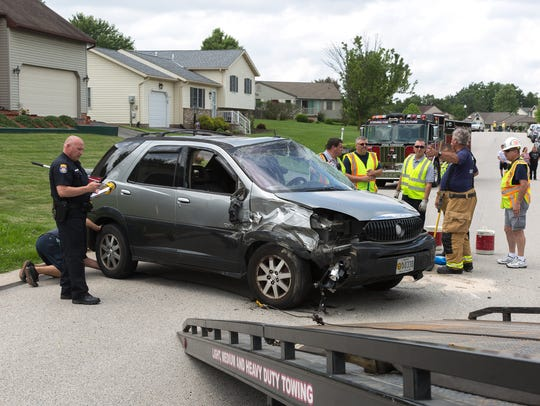 Emergency crews work at the scene of a crash with rollover on the 100 block of West Timber Lane, Wednesday, May 30, 2018 in Penn Township.