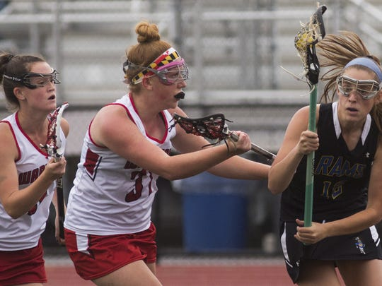 Kennard-Dale's Mackenzie Young, right, controls the ball. Kennard-Dale defeats Susquehannock 11-9 in their PIAA Class 2A girls' lacrosse semifinal game at Central York High School in Springettsbury Township, Tuesday, June 5, 2018.