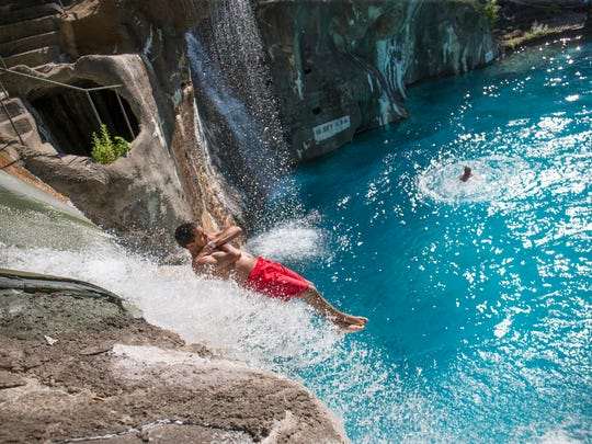 "A rider slides off Bombs Away at Mountain Creek Water Park in Vernon, N.J. The park formerly known as Action Park opens for its 2018 season on June 9 as a movie poking fun at its past, ""Action Point,"" shows in theaters nationwide."