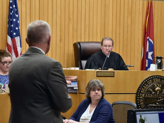 Knox County Criminal Court Judge Bob McGee, right, asks Knox County Assistant Attorney General Leland Price, left, about a trial date for accused killer Eric Boyd during a status hearing Wednesday, June 6, 2018, in Knox County Criminal Court.