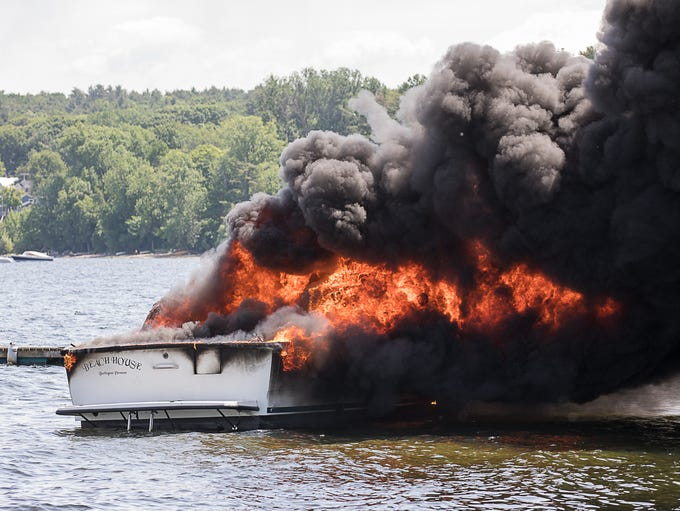 "The 31-foot private boat ""Beach House"" burns in Inner"