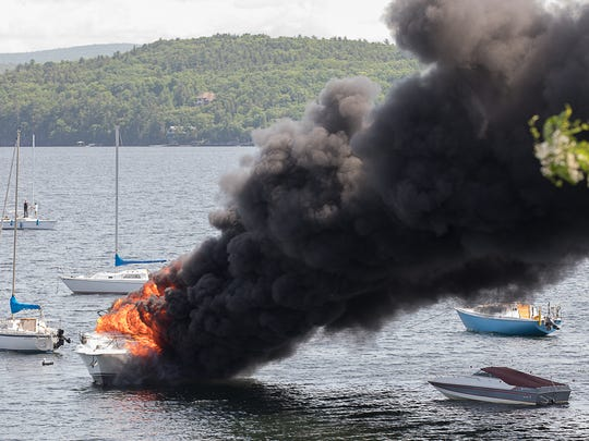 """The 31-foot """"Beach House"""" burns in Inner Malletts Bay on Saturday, June, 9, 2018, in Colchester."""
