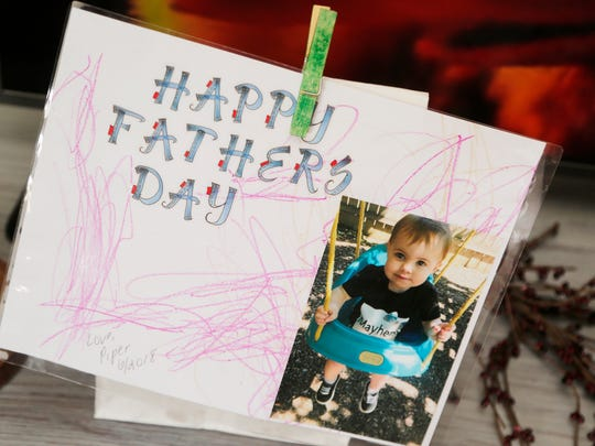 A Fathers Day card for Ryan Morris created by his daughter, Piper Rose Morris, Thursday, June 14, 2018, inside their Lafayette apartment. Morris, who suffers from kidney disease, wasn't able to spend much time playing with his daughter until recently. Now with dialysis, Ryan and Piper Rose are able to spend more time together playing outdoors.