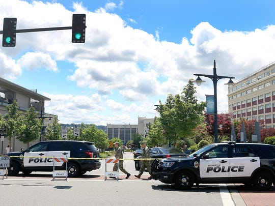 Bremerton police block off Burwell Street and Pacific Avenue in downtown Bremerton on Thursday after a suspicious package was found inside the gates of Puget Sound Naval Shipyard.
