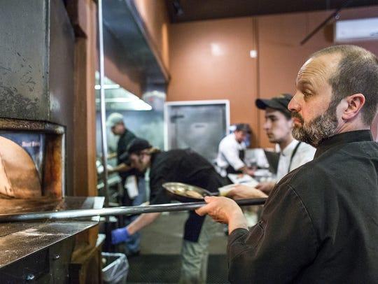 Peter Affatato, right, owner and chef of Nona Mia,
