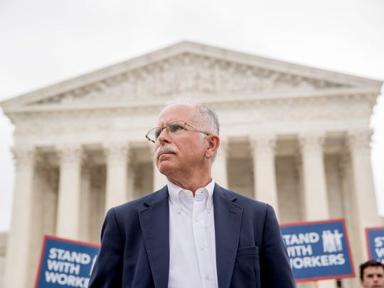 Plaintiff Mark Janus stands outside the Supreme Court