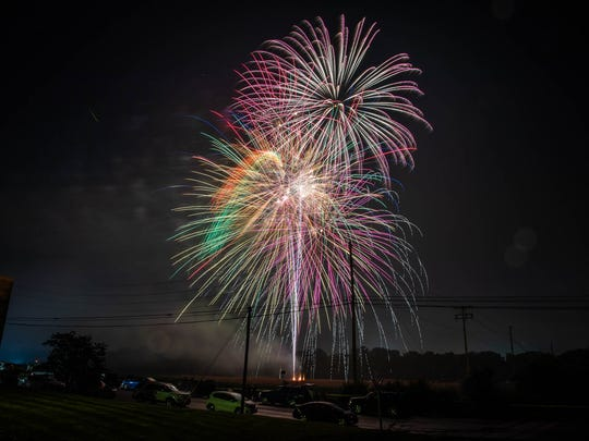 In a long exposure image, fireworks explode in the sky over Moul Field during the 2018 Liberty Day Celebration, on July 4, 2018, in Hanover.