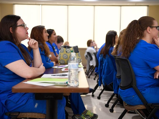 Nursing residents take notes during a lecture at Jackson-Madison
