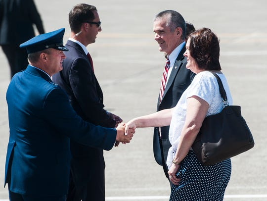 Col. Buel Dickson greets Jean and Matt Rosendale before President Donald Trump steps off of Air Force One at the Great Falls International Airport on Thursday.