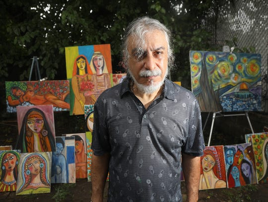 Paterson artist, Said Elatab with his paintings. He