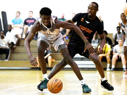 MSU's Gabe Brown, left, and Joshua Langford, right, battled for a ball during a contentious game during the Moneyball Pro-Am last summer.