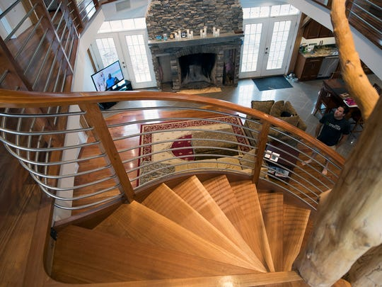 This is the view from atop an indoor cherry wood spiral staircase that blends with an actual ash tree at Paul Kaplan's home in northern York County.