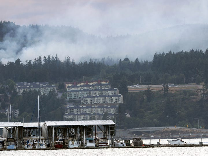 A fire burns in the Bremerton Watershed in a view from