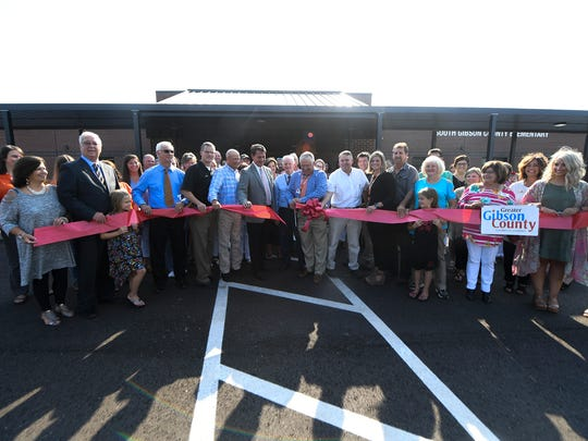 South Gibson County Elementary School principal Billy Carey is joined with teachers and community leaders as he cuts the ribbon to the new South Gibson County Elementary School, Tuesday, July 24.