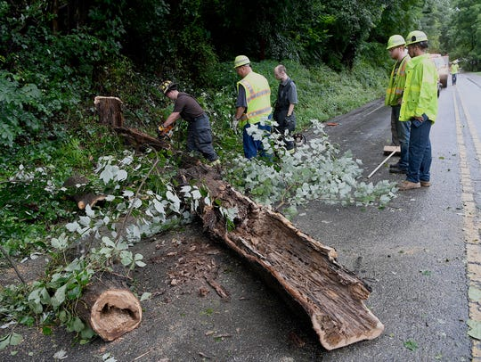 Yoe fire fighters and a PennDOT road crew remove a