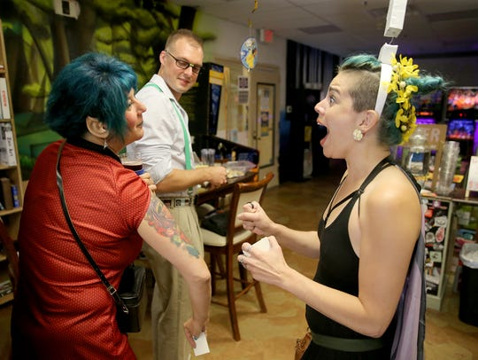 Michelle Bellon of Port Orchard shows her tattoos to