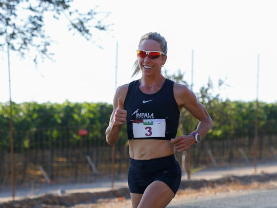 Jen Bayliss, 47, of San Ramon won the women's division of the Salinas Valley Half Marathon.
