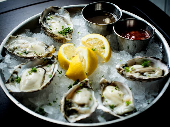 Oysters with lemon, mignonette and cocktail sauce at
