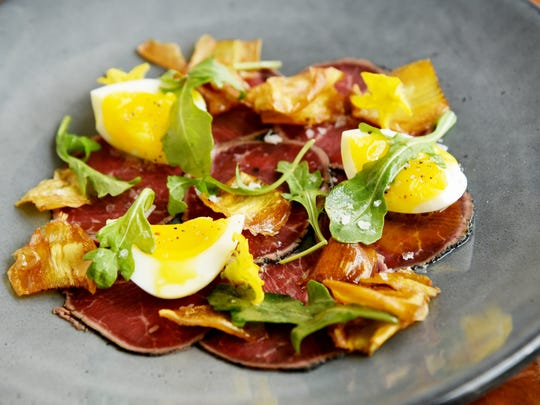 Beef carpaccio with crispy baby artichokes, soft-boiled