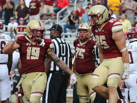Ben Glines (19) fires up his Boston College teammates.