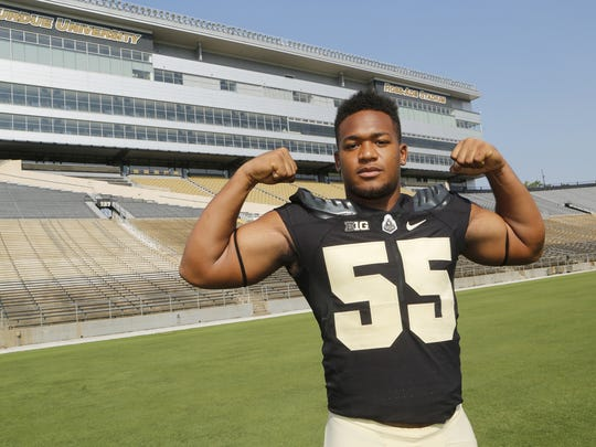 Derrick Barnes flexes his muscles Purdue football media day Thursday, August 3, 2017, in West Lafayette.