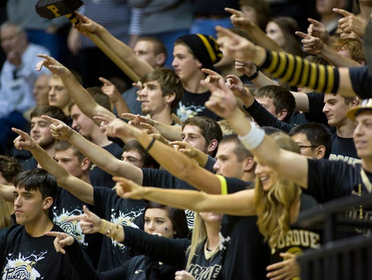 "The Purdue Paint Crew cheers during a game against Carroll at Mackey Arena in 2014. No one is sure exactly when the ""IU Sucks"" chant started, but by 2014 it was in full force."